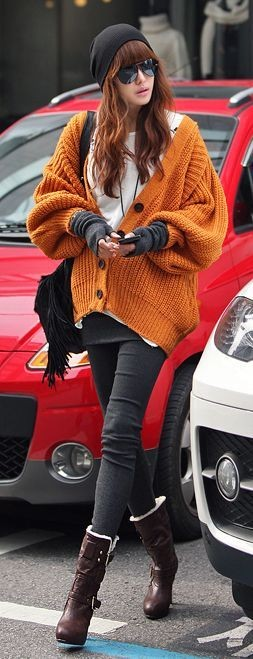 تنسيق اللون البرتقالي في الملابس