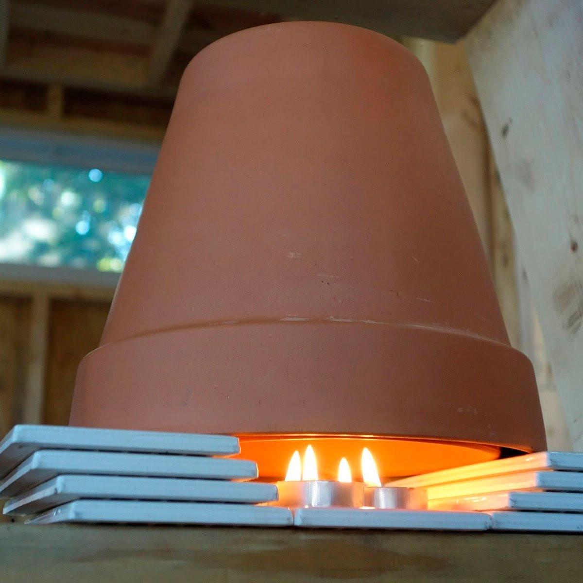 أفكار لتدفئة البيت - إشعال الشموع ومصابيح الإضاءة الهادئة